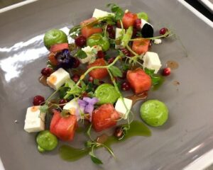 Fresh summer salad with cheese and fresh fruit