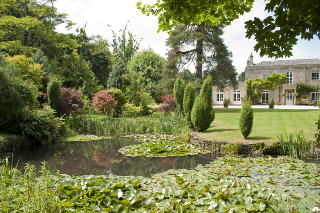 Pond, gardens and main country house at Guyers House Hotel & Restaurant