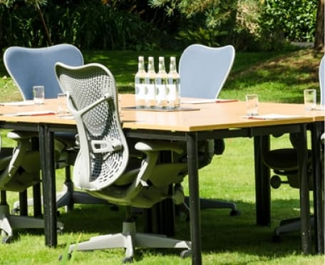 Outdoor corporate table and chairs with water bottles and glasses at Guyers House Hotel