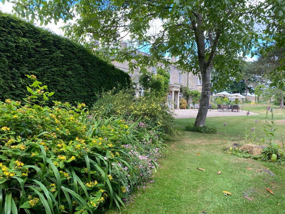 Gardens, outdoor dining area and main country house at Guyers House Hotel & Restaurant