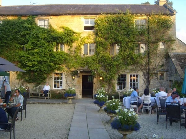 Outdoor dining area and main country house at Guyers House Hotel & Restaurant