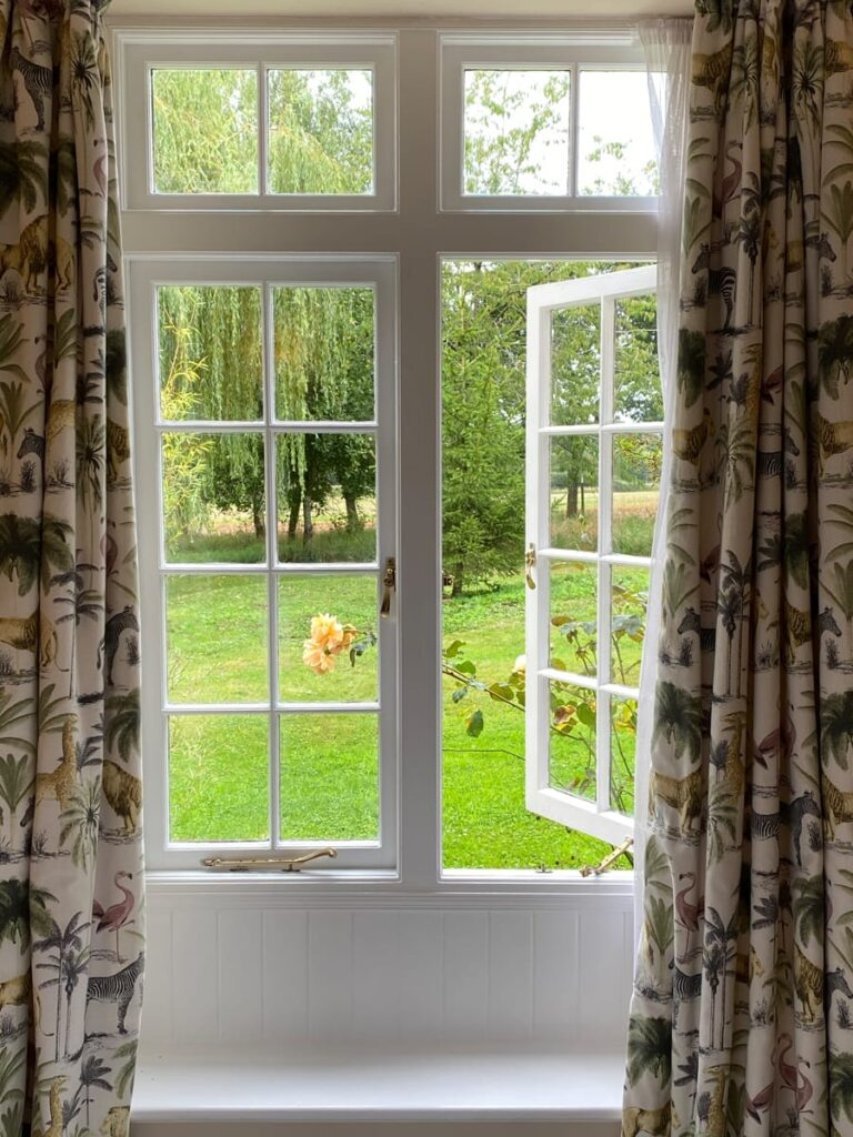 Window overlooking the gardens at Guyers House Hotel