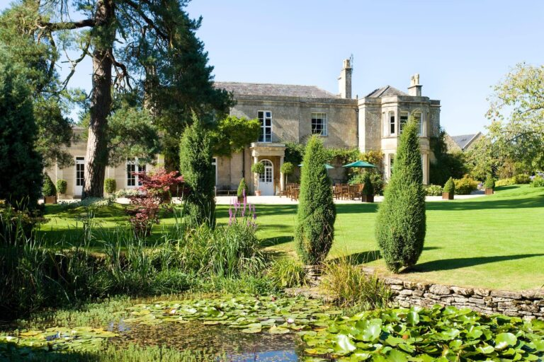 Pond, gardens, outdoor seating areas and main country house at Guyers House Hotel & Restaurant